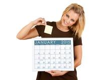 Kalender 2015: Setzen einer klebrigen Anmerkung auf ein Datum Lizenzfreies Stockfoto
