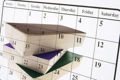 Kalender und Bücher Stockfoto