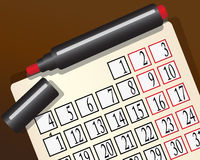 Kalender und eine rote Markierung Stockbild