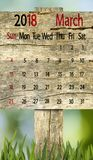 Kalender voor 2018 Maart op houten raadsachtergrond Stock Fotografie