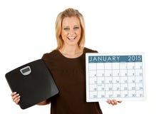 2015 Kalender: Vrouw aan Dieet in Januari wordt opgewekt dat Royalty-vrije Stock Foto