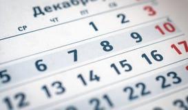 Kalendern numrerar sex, sju, åtta, nio, röda tio översätter: månad av December Royaltyfri Fotografi