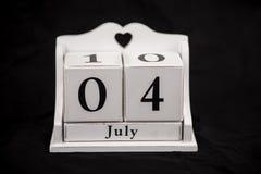Kalendern skära i tärningar Juli, fjärdedel, 4, 4th Fotografering för Bildbyråer