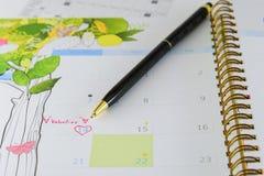 Kalenderpagina met een detail van de valentijnskaartdag Stock Fotografie