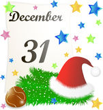 Kalendersida med juldetaljer Arkivfoto