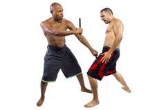 Kali Escrima Arnis Martial Artists. Two martial artists sparring with Kali Escrima or Arnis Royalty Free Stock Photo