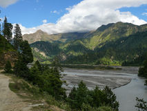 Kali Gandaki river and Nilgiri in the clouds, Nepal Royalty Free Stock Photos