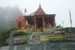 Kali Temple. A temple to the Goddess Kali on top of a mountain in remote Shojha, Himachal Pradesh, India, cloudy conifers in the background Stock Images
