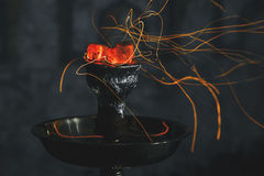 Kalian shisha hookah red hot coals. Sparks from breathe Stock Photography