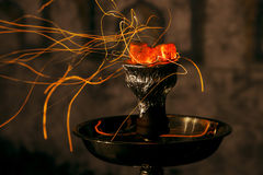 Kalian shisha hookah red hot coals. Sparks from breathe. Shisha hookah red hot coals. Sparks from breathe Stock Photos