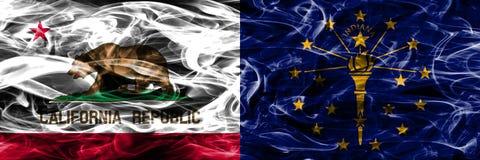 Kalifornia vs Indiana pojęcia dymu kolorowe flaga umieszczający boczny b zdjęcia stock