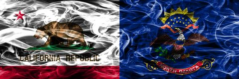 Kalifornien vs North Dakota färgrik begreppsrök sjunker förlagt s arkivbild