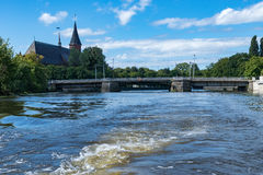 Kaliningrad. Beautiful views of the ancient bridge and Cathedral the name of Kant from the Pregel river Royalty Free Stock Photography