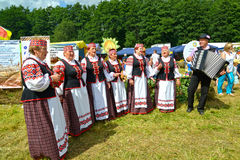 KALININGRAD REGION, RUSSIA. The Belarusian national folklore ensemble acts on an agricultural holiday. KALININGRAD REGION, RUSSIA - AUGUST 05, 2017: The royalty free stock photography