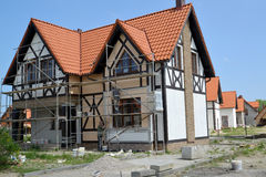 KALININGRAD REGION, RUSSIA. Finishing works on a facade of a new cottage Royalty Free Stock Image
