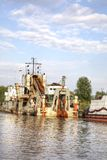 Kaliningrad. River Pregolya. Multiple self-propelled dredger royalty free stock photography