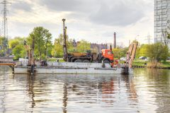 Kaliningrad. Cargo port. Drill rig on a barge royalty free stock photography