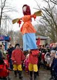 KALININGRAD, RUSSIA. Buffoons bear an effigy at the celebration of Maslenitsa in the park. KALININGRAD, RUSSIA - FEBRUARY 18, 2018: Buffoons bear an effigy at royalty free stock photos