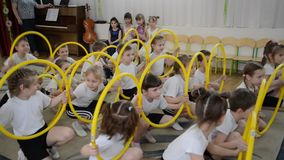 Kaliningrad, Russia. A demonstration sports performance with hoops. A morning performance in kindergarten stock footage