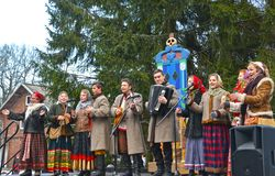 KALININGRAD, RUSSIA. Actors of national ensemble speak in the park at the celebration of Maslenitsa. KALININGRAD, RUSSIA - FEBRUARY 18, 2018: Actors of national stock photo
