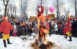 KALININGRAD, RUSSIA. The burning effigy at the celebration of Maslenitsa in the park. KALININGRAD, RUSSIA - FEBRUARY 18, 2018: The burning effigy at the royalty free stock photo
