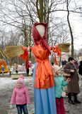 KALININGRAD, RUSSIA. Children stand near Maslenitsa effigy in the city park. KALININGRAD, RUSSIA - FEBRUARY 18, 2018: Children stand near Maslenitsa effigy in royalty free stock images