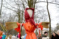 KALININGRAD, RUSSIA. Maslenitsa effigy fragment with brooms instead of hands. A holiday in the park. KALININGRAD, RUSSIA - FEBRUARY 18, 2018: Maslenitsa effigy royalty free stock photo