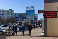 Kaliningrad, Russia - February 26, 2019: People going to office at the main street of city in sunny spring day stock photos