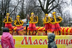 KALININGRAD, RUSSIA. The youth Russian national folklore ensemble acts on Maslenitsa holiday. Russian text `Maslenitsa`. KALININGRAD, RUSSIA - FEBRUARY 26, 2017 royalty free stock image