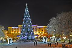 KALININGRAD, RUSSIA. Festive New Year`s illumination and fir-tree in the winter evening. Victory Square. KALININGRAD, RUSSIA - DECEMBER 24, 2018: Festive New royalty free stock photos