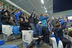 KALININGRAD, RUSSIA. Football fans rejoice to the scored goal. Baltic Arena stadium. KALININGRAD, RUSSIA - APRIL 11, 2018: Football fans rejoice to the scored royalty free stock photos
