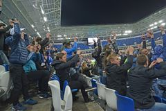 KALININGRAD, RUSSIA. Football fans rejoice to the scored goal. Baltic Arena stadium. KALININGRAD, RUSSIA - APRIL 11, 2018: Football fans rejoice to the scored royalty free stock photography