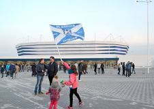 KALININGRAD, RUSSIA. The girl waves a flag of ffootball club Baltika against the background of Baltic Arena stadium Royalty Free Stock Photography
