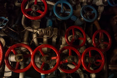 KALININGRAD, RUSSIA - JUNE 12 2017: Close-up view of red and blue valves of different sizes, a machinery engineering interior Stock Images