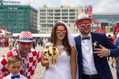Kaliningrad, Russia, 16 June 2018. Decorated and elegant Croatian fans are preparing for the football match of their team with the stock image