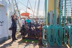 KALININGRAD, RUSSIA - JUNE 19, 2016: Tourists on the famous historical barque Kruzenshtern prior Padua. Tourists on the famous historical barque Kruzenshtern stock image
