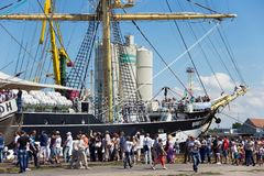 KALININGRAD, RUSSIA - JUNE 19, 2016: Tourists near the famous barque Kruzenshtern prior Padua moored in the pier of Kaliningrad. Launched in 1926, she was Stock Photography
