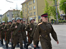 KALININGRAD, RUSSIA - MAY 09, 2015: Group of soldiers in a milit Stock Images