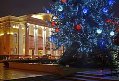 KALININGRAD, RUSSIA. New Year tree and building of Regional drama theater late evening Stock Photos