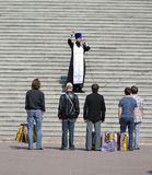 KALININGRAD, RUSSIA. The orthodox priest says a prayer at steps of the Cathedral of Christ the Saviour Stock Image