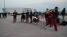 Kaliningrad, Russia. A performance of ensemble of brass wind instruments about Baltic Arena stadium stock video