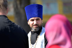KALININGRAD, RUSSIA. Portrait of the orthodox priest in a blue kamelaukion Royalty Free Stock Photo