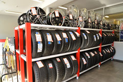 KALININGRAD, RUSSIA. A rack with tires and rims in a trading floor Stock Photos