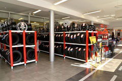 KALININGRAD, RUSSIA. Racks with tires and rims in a trading floor. Shop of an autotechnical center Stock Photo
