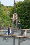 KALININGRAD, RUSSIA.  Slingers accept and establish a metal design. Construction of a road platform Stock Images