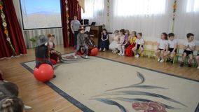 Kaliningrad, Russia. Small children execute dance of cowboys. A morning performance in kindergarten stock video footage