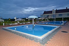 KALININGRAD, RUSSIA. Two outdoor swimming pools  in the territory of RiverSide hotel complex. KALININGRAD, RUSSIA - JUNE 25, 2017: Two outdoor swimming pools in Royalty Free Stock Photos