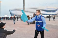 KALININGRAD, RUSSIA. The volunteer of the FIFA World Cup of 2018 with the index on a hand. Baltic Arena stadium royalty free stock photography