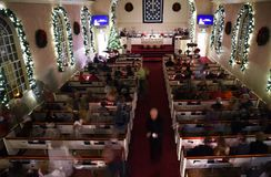 Candlelight Service. KALISPELL, MONTANA, USA - December 24, 2017: Parishners at Epworth United Methodist Church leave the pews after a Christmas Eve candlelight stock photo