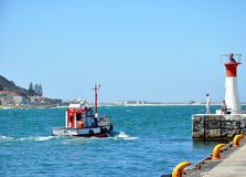 Kalk Bay Harbor Cape Town, South Africa. Kalk Bay Harbor on the Eastern side of the Cape peninsula is a small commercial fishing harbor from where trawlers Stock Images